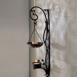 "Mesa Metalworks Dancing Light Diffuser  Spread a beautiful glimmer of light and an amazing scent! Metal diffuser attaches to any wall. Does not include candles or wax. 11⁄2""w x 4""d x 131⁄2""h $22.99"