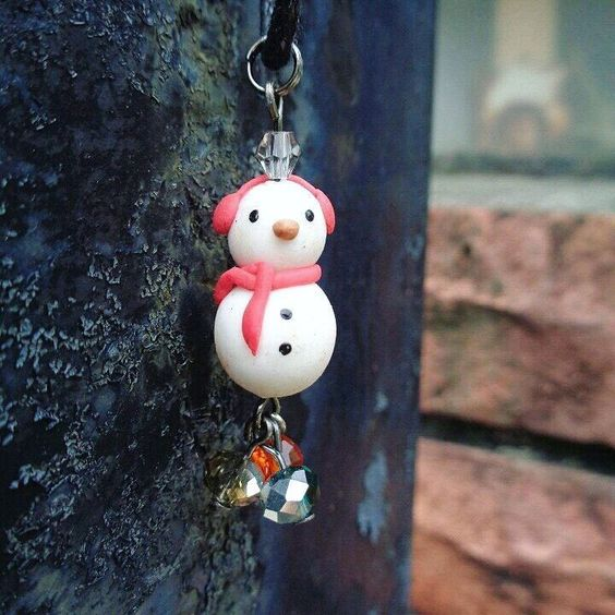 Throwback to my christmas clay snowman pendant  Its still available if anyone love snowmans xD ----------------------------------------------------------- Check out the rest of my clay collections at http://ift.tt/1MWiM3f & http://ift.tt/1SZ9hUg  #christmas #throwback #clay #handmade #pendant #necklace #snowman #scarf #beads #available #sale #esty #xiakirasketches by xiakirasketches