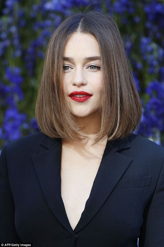 Preened to perfection: Emilia's hair and beauty gave an affirmative nod to the host nation with her bob styled in a middle parting and lightly curled under while a deep red lip offered an extra glam touch
