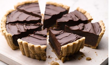 Crisp pecan crust bourbon chocolate tart..Dan Lepard recipe
