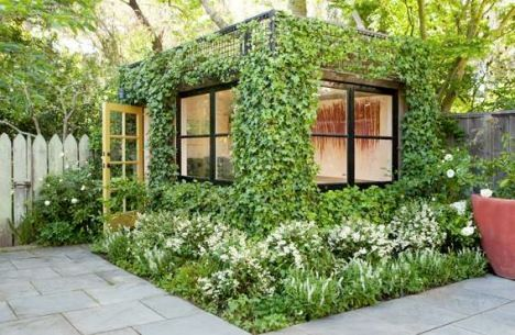 The former garden shed was converted into an eye-catching art studio by encasing it in an ivy-covered framework.