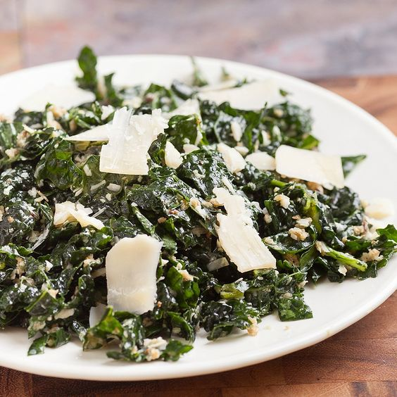 Quick savory kale salad recipe will remind you of your favorite Cesar salad, but without all the dressing! Inspired by Dr. Weil True Food Kitchen cookbook.