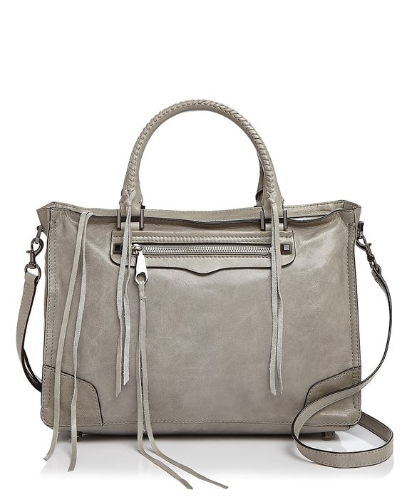 Rebecca Minkoff adds a new silhouette to her impressive repertoire with the Regan satchel, a right-sized every day option equipped with an optional crossbody strap and chic, moto-inspired accents like