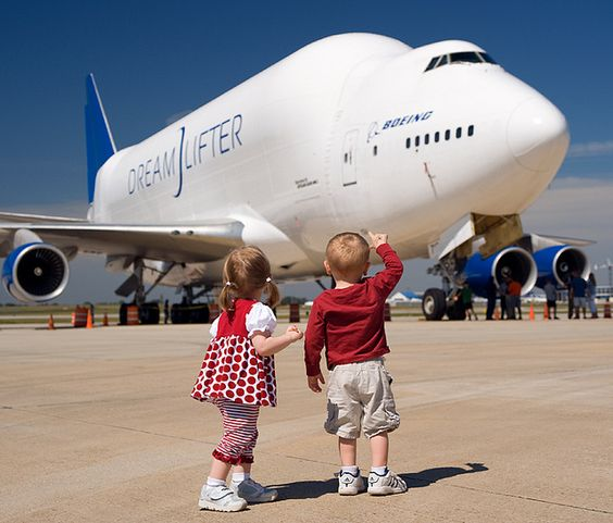 Children admire the 747 Dreamlifter. A Boeing photographer  took this photo during a family day at Boeing. This image reminds us that aviation remains full of wonder and magic.