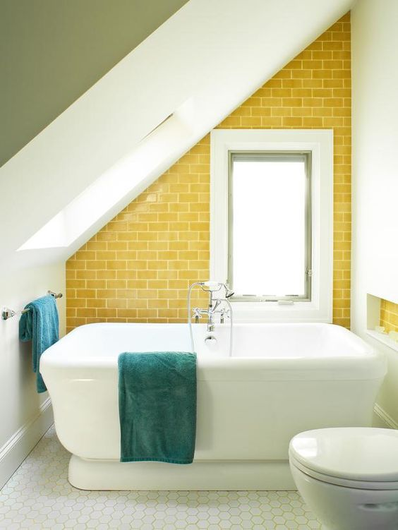 Yellow tiles add an unexpected accent to this bathroom's angled wall. (http://www.hgtv.com/designers-portfolio/room/eclectic/bathrooms/9739/index.html?soc=Pinterest)