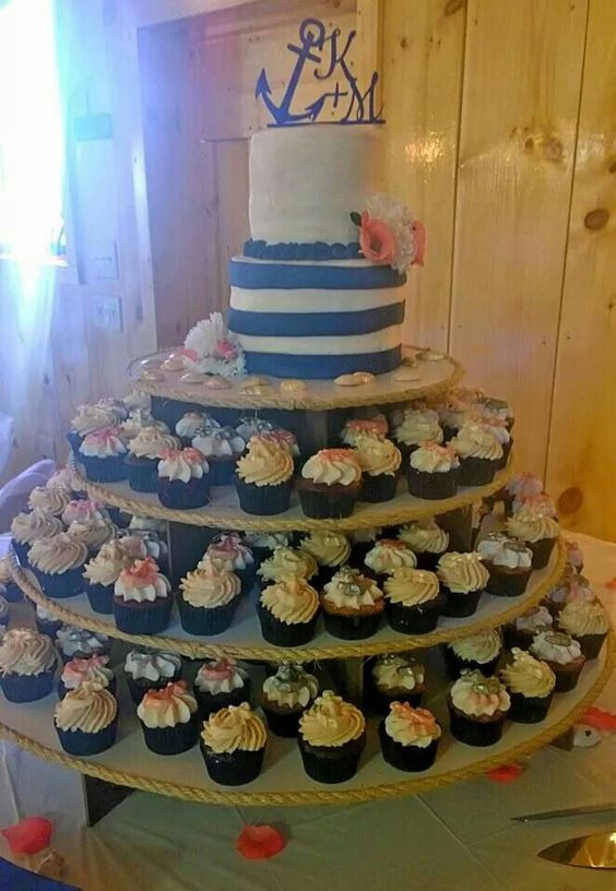 Anchor Wedding Cake and cupcakes with white chocolate anchors and seashells.