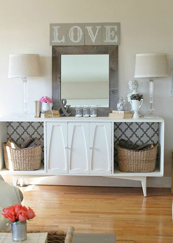 ALTERNATE STORAGE - Don't let the cabinet drawers or doors inhibit your creativity. By removing the doors and wallpapering the back, it opens up the space for baskets and boxes and other things that wouldn't normally fit in a credenza. For inspiration, think child's toy box. www.buffetsandcabinets.com
