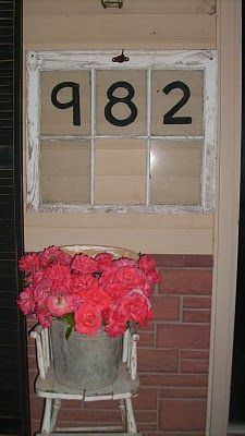 House Numbers in Old Window.