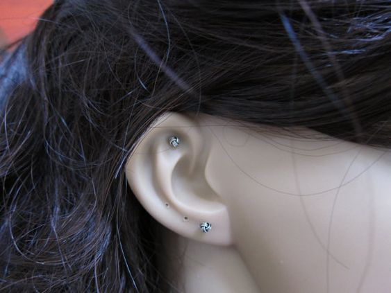 This listing is for one stud, not for a pair . If you want a pair of this ,please check on the  Ear Studs Section of my shop