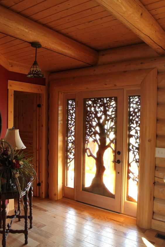 Hand carved wooden front door in a tree design - looks even more amazing when the light shines through...x: