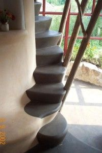 Stairs to loft...but mine will be built up an outside wall, with natural tree branch railings.