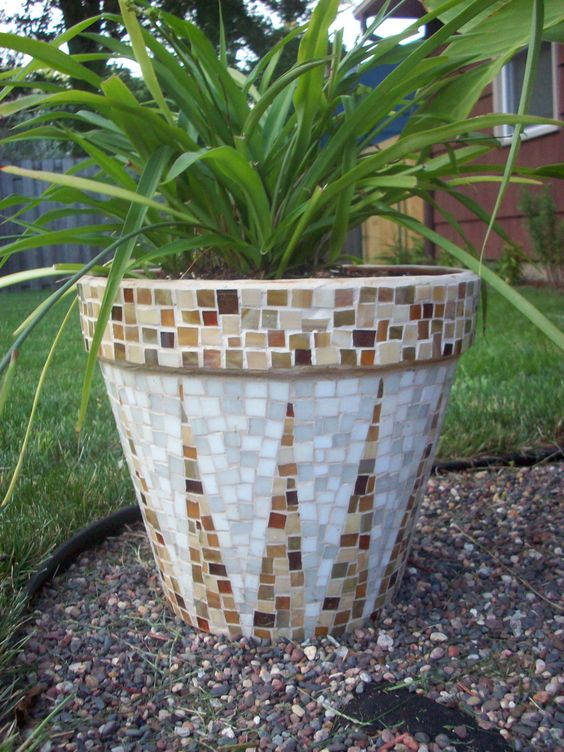 Love this! Great job whoever made this!......Original pinner said: Mosaic pot I made