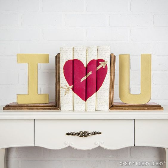 Decorating your home for Valentine's Day? Create this bookend with patterned paper, paper mache letters and a touch of creativity! #ValentinesDay
