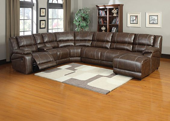 MILLER Spacious seating and plush full cushions make the Miller sectional truly exceptional. Upholstered in a rugged saddle brown reconstituted leather, the Miller brings together a left arm facing reclining chair, an armless reclining chair, storage console, corner wedge, armless loveseat, and a cushy pushback chaise with right facing arm. Contrasting topstitching and manual reclining mechanisms finish off what is sure to be the most comfortable furniture piece in the home.