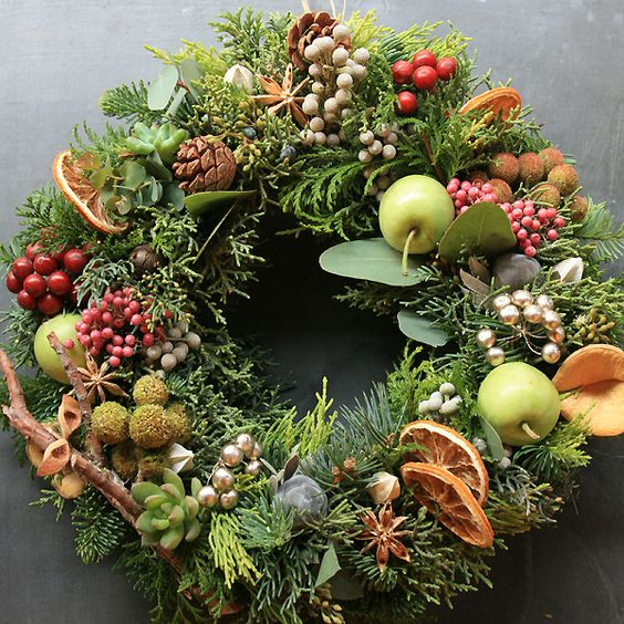 Stunning wreath with fruits berries holiday greens for Apple fruit decoration