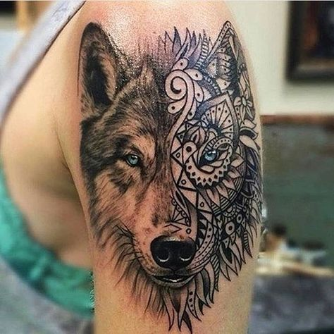 Realistic Looking Colored Shoulder Tattoo Of Wolf Head With Ornamental Mask Tattoos Wolf Tattoos Tribal Tattoos