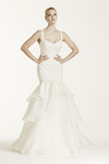 Want something more dramatic? This Truly Zac Posen tank trumpet gown with tiered skirt in ivory, exclusively at David's Bridal, will make a grand statement as you enter the ballroom for your first dance.  Truly Zac Posen exclusively at David's Bridal, tank trumpet gown with tiered skirt, $950,  davidsbridal.com