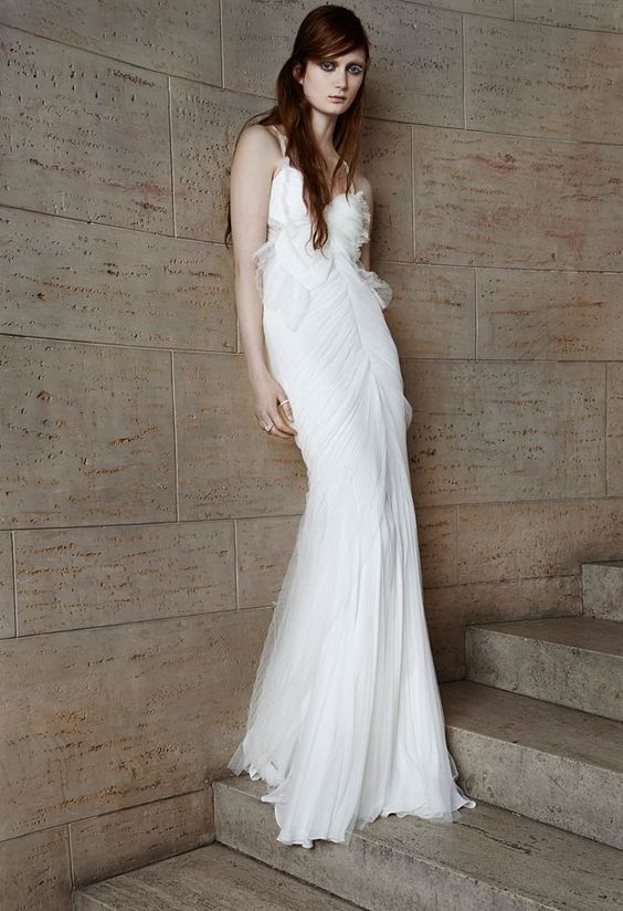 Vera Wang Spring 2015 Bridal Collection - Ivory pleated tulle mermaid gown with sweetheart neckline, cotton ribbon straps, cut-out back and godet skirt.