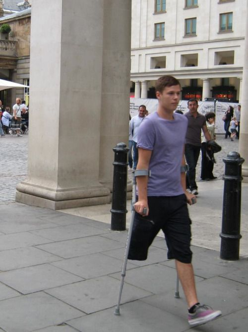 teen boy on crutches