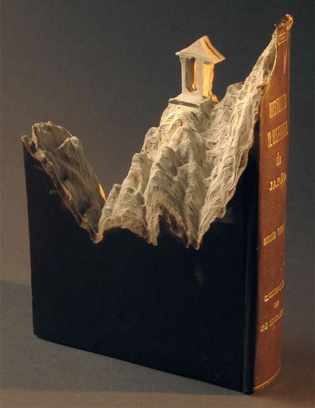 landscape sculpture carved out of a book by artist Guy Laramee // Albtraum der Bibliothekare