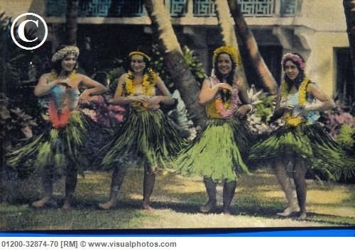 c.1935 Happy hula girls with sunny scenes wearing grass skirts.  PHOTO: Hawaiian Legacy Archive  / Pacific Stock