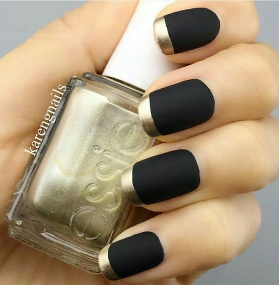 Matte black nail polish with gold tips