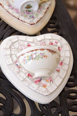 Wall Pocket...this is really cute but could not find instructions. Looks like a teacup has been cut in half (don't know how to do that) and one half broken into pieces and glued onto the painted wooden heart and then the other half glued onto the wooden plaque.  Just guessing at this point