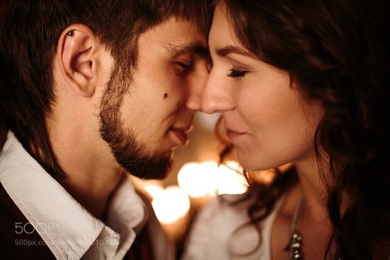 Beautiful Couple with Closed Eyes Kissing by dariazu