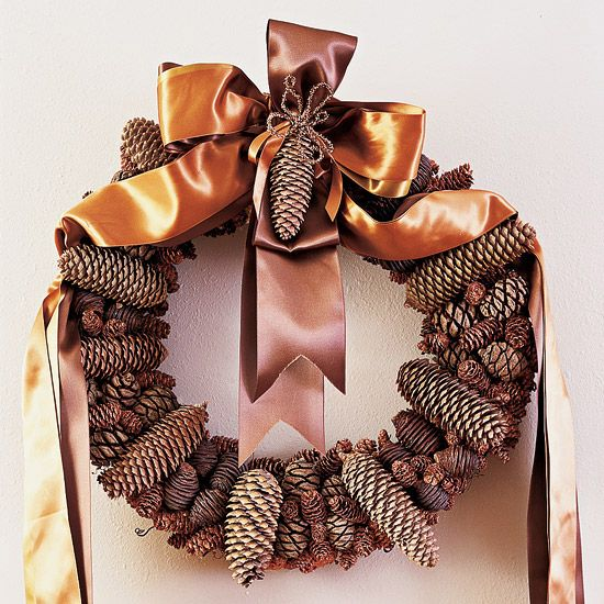 Satin ribbon + pinecones = perfection. We love the unconventional look of this decorative wreath.