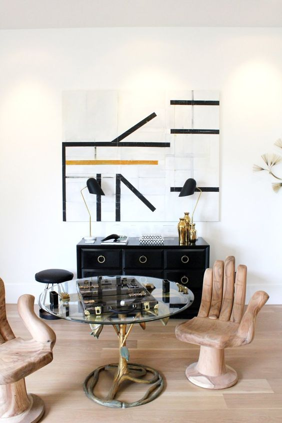 Pin for Later: How to Make Affordable Decor Look Expensive  Black and gold is the theme of this nook, except for the unique wooden hand chairs from Shop Candelabra. Would you guess they cost under $1,000?