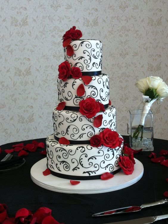 Elegant red, black and white wedding cake.  Event and photo by www.annachristineevents.com  Cake by It's Tasty Too