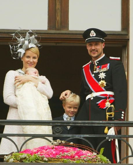 Crown Princess Mette-Marit holding Princess Ingrid Alexandra, her son Marius Borg Høiby, and Crown Prince Haakon greet the public from the balcony of the Royal Palace after the christening of Princess Ingrid Alexandra on 17 April 2004.