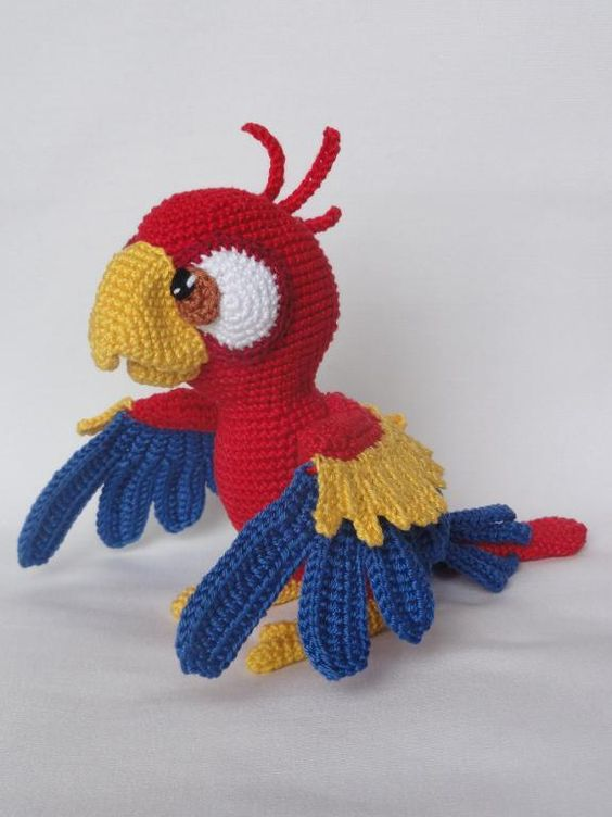 Omg he's SO cute! He looks like a red version of Blue from Rio!   -Chili the Parrot Amigurumi Crochet: