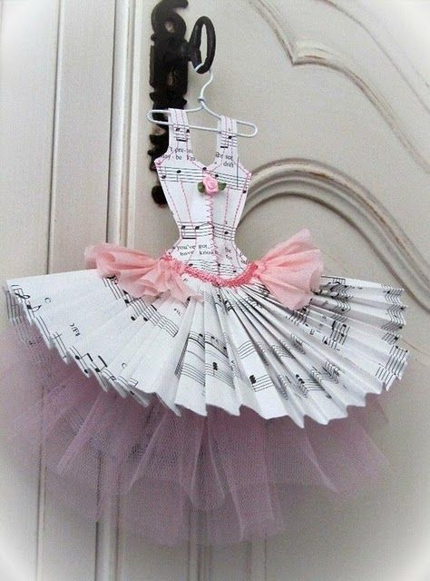 could be Nutcracker sheet music for Snow Queen ornament with white lace