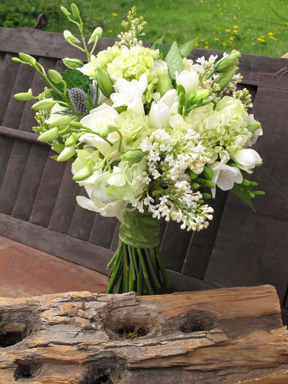 Spring bridal bouquet of white lilacs, freesia, roses, orchids, hydrangea, lisianthus and thistle.wedding flower bouquet, bridal bouquet, wedding flowers, add pic source on comment and we will update it. www.myfloweraffair.com can create this beautiful wedding flower look.