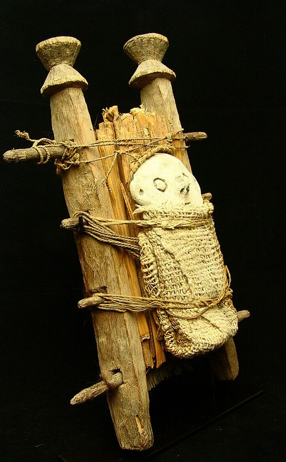"""Uniquely fashioned large Chancay Ceremonial Scene. Ultra rare to see this type of depiction from the Chancay culture using the combination of these simple materials. Laid upon a bed of reed slats, an unfired solid clay doll (6.5""""/16,51cm) is wrapped using a cotton textile blanket and secured with string between carved wooden beams. A substantial amount of personal care was given in its assembly. Coarse human hair is braided, then intertwined between wooden sticks to construct and secure the…"""