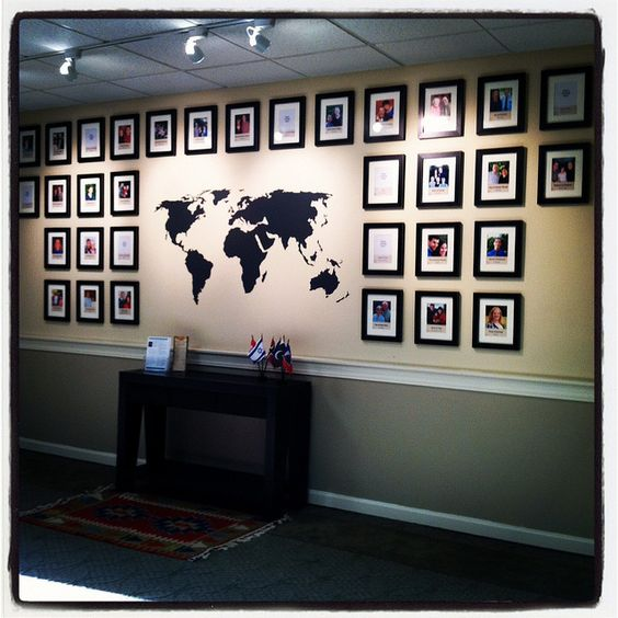 very clean missionary display - can't do this in my house, but maybe one of those frames 5 or 7 4x6's connected to put their photos/postcards in next to the VOM map?