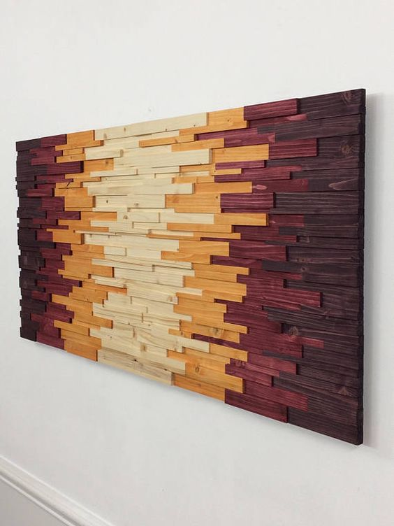 Welcome to Stains And Grains, custom compositions in wood. Be sure to check out the links to my other brands/shops lower down in the description. This piece of gorgeous wooden wall art is made of 300 individual pieces of wood at different heights and lengths, giving it a really