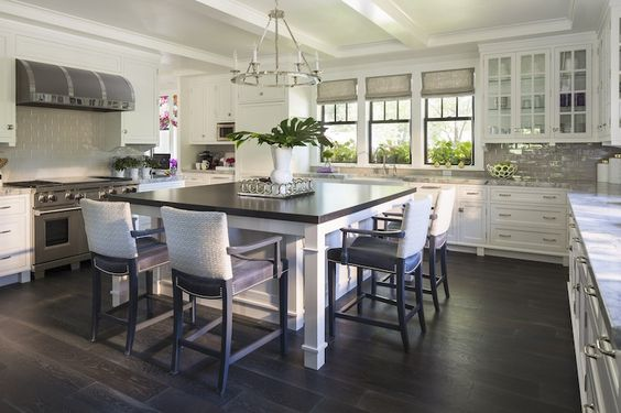 U Shaped Kitchen With Square Kitchen Island Topped With A Honed Black Counter Lined With Gray