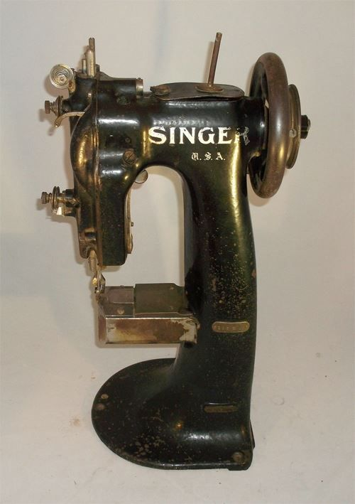 Funny little machine on ebay now. It's a Class 123 W Needle Feed Short Horizontal Cylinder Machine. Kind of cool! http://www.ebay.com/itm/Singer-Sewing-Machine-Model-123-W-1-Serial-W547631-/281189990917?pt=LH_DefaultDomain_0&hash=item41783ac205: