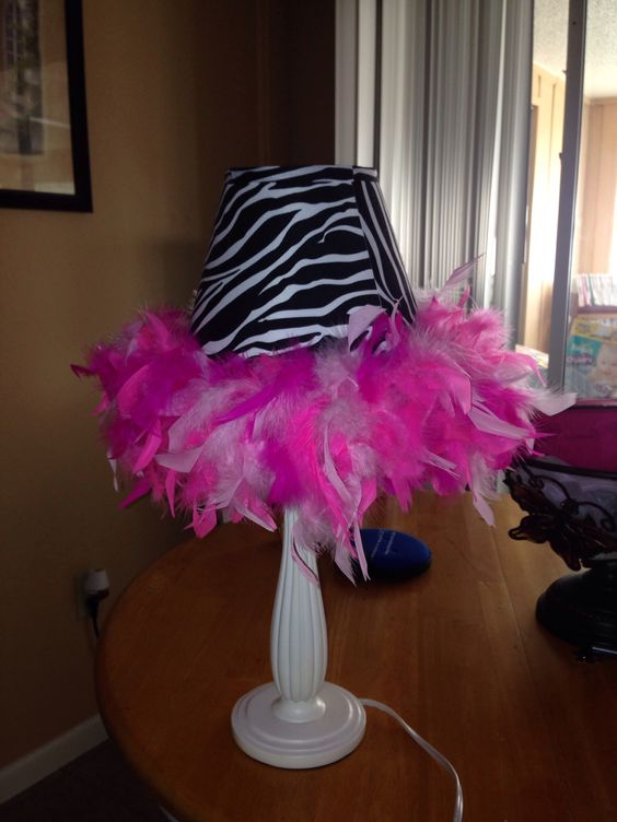 DIY lamp shade all you need for this is a small lamp shade any of your choice, a feather boa any color, glue gun , and hot glue sticks!!!.
