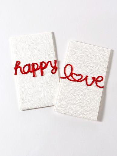 """MARUAI 「MARUAI」の「こち」シリーズの""""Happy""""""""Love""""と、アルファベットで綴られたメッセージを水引で斬新にアレンジした祝儀袋は、贈る人も贈られる人も思わず微笑んでしまう、楽しさいっぱいのグッドデザイン。"""