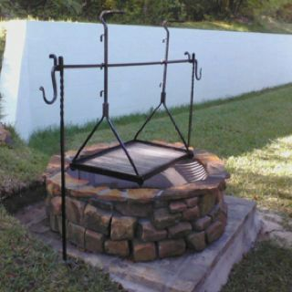 Fire pit grill and tripod in place blacksmith for Easy diy fire pit with grill