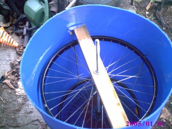 Homemade honey extractor made from bike wheels so it for Making bicycle wheels