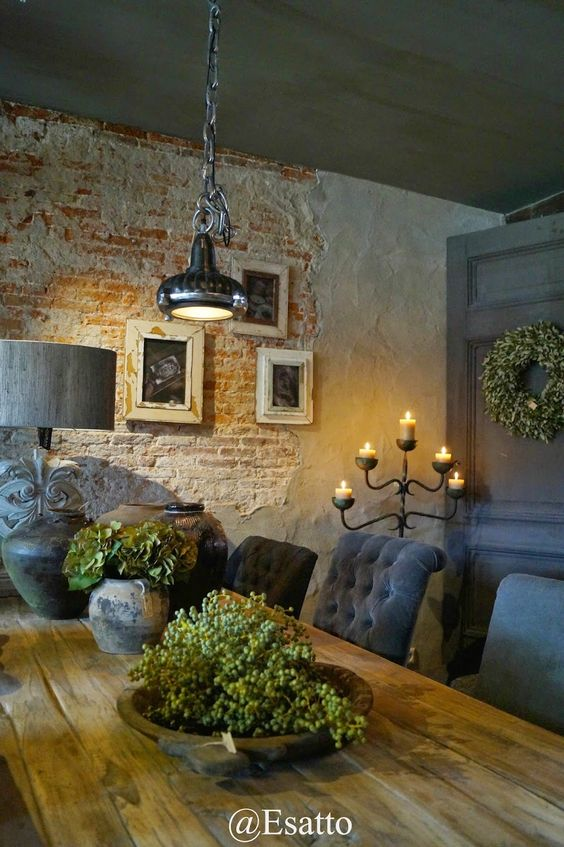 Love the exposed brick and rustic farm table with upholstered chairs: