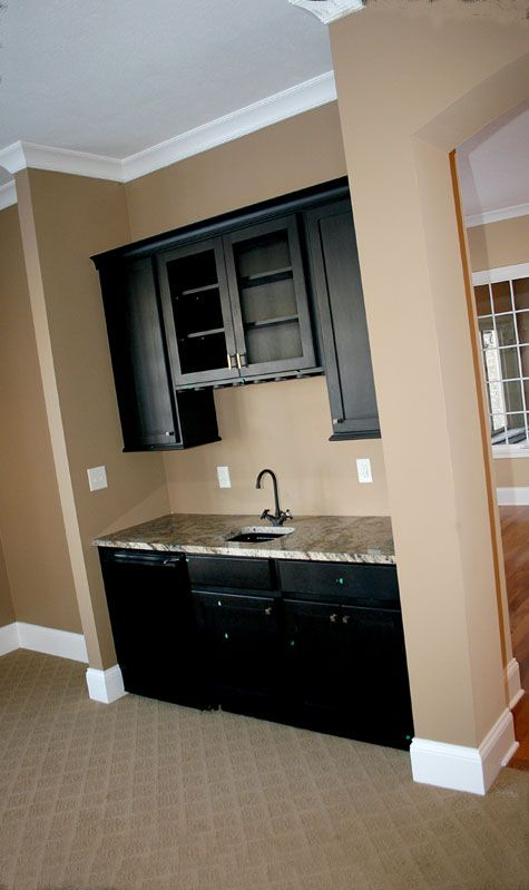 Idea close up view family room wet bar w built in glass racks granite counter wall mounted - Wall bar counter ...