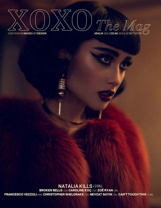Dark-haired beauty / musician Natalia Kills shows off her seductive side in sizzling bedroom-inspired looks for XOXO Magazine.