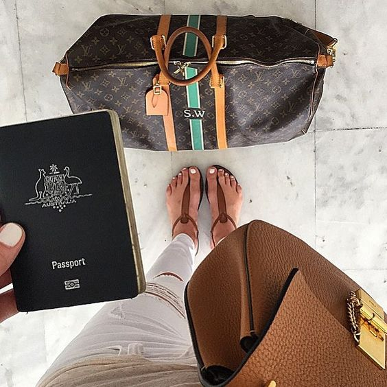 Travel style inspiration   the perfect summer holiday travel look from @samanthawills: white jeans tan sandals white mani pedi and chic monogrammed @louisvuitton carry on. #traveloffen #offenstore #travelsize