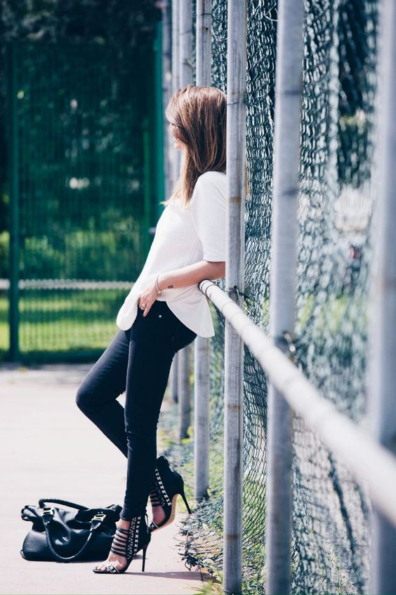 Nicoletta Reggio is wearing an oversized white shirt from Zara, trousers fromRefrigiwear, shoes fromL.A.M.B. and a bag from Chloe