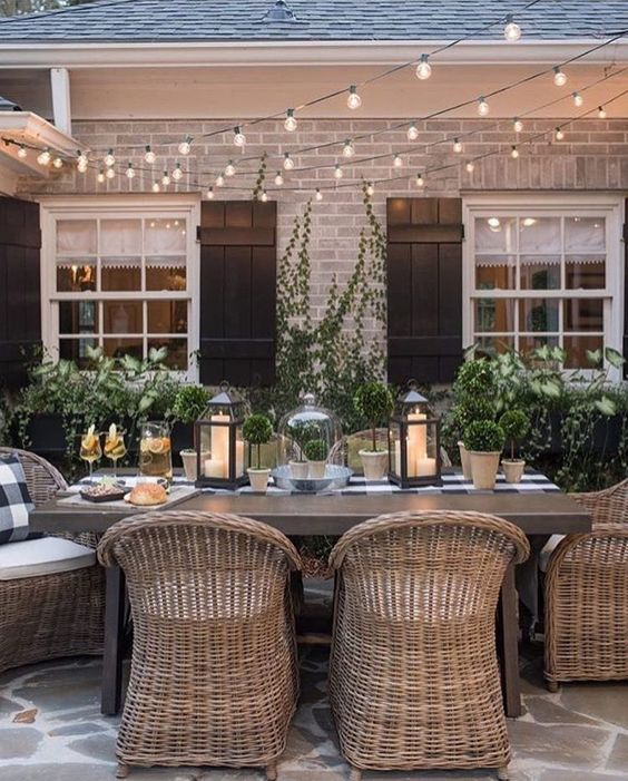 Why this space works. Wicker chairs, texture of the greenery, the use of black, white and cement create a formal yet natural elegance. Win win